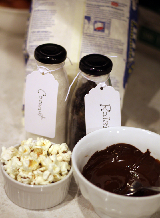 Creation 2: dark chocolate, coconut, chopped raisins, popcorn & chilli. This is delicious.